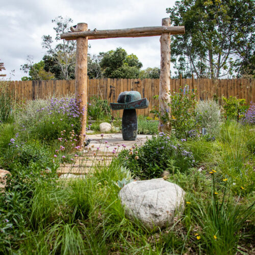 Natural materials and CA native plants add interest to a modern design.